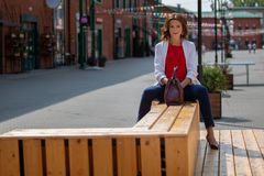 Portrait of a beautiful stylish business woman outdoors Stock Images