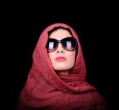 Portrait of beautiful stylish caucasian woman against black back Stock Photos