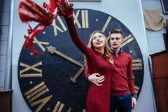 Portrait of beautiful stylish couple standing near the clock. A Stock Image