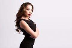 Portrait of a beautiful stylish woman in a black dress. Royalty Free Stock Photo