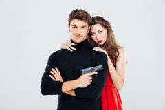 Portrait of beautiful stylish young couple with gun Royalty Free Stock Image