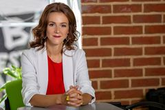 Portrait of a beautiful successful business woman indoors Royalty Free Stock Images