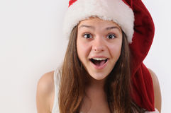 Portrait of beautiful surprised girl in Santa hat Stock Images