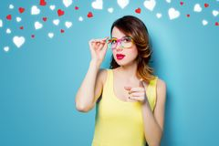 Young surprised woman in glasses with hearts royalty free stock photos