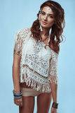 Portrait of beautiful swag young hippie woman. Portrait of beautiful glamor hipster young hippie woman in knitted shirt Stock Photo