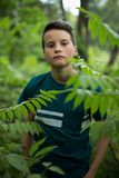 Portrait of beautiful teen boy in forest royalty free stock photo