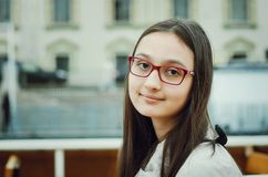 Portrait of a beautiful teen girl with glasses stock photo