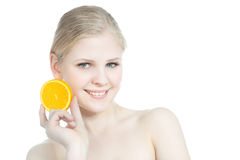 Portrait of a beautiful teen girl with orange over Royalty Free Stock Photo