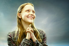 Portrait of a beautiful teen girl smiling. On a sky background Royalty Free Stock Images