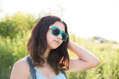 Portrait of beautiful teen girl in sunglasses Stock Photos