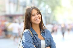 Portrait of a beautiful teen with perfect smile. Portrait of a beautiful teen posing looking at camera with perfect smile in the street Royalty Free Stock Image