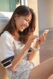 Portrait of beautiful teen woman chat social media on smrt phone Royalty Free Stock Images