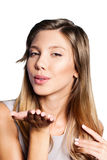 Portrait of beautiful teenage girl blowing a kiss Royalty Free Stock Photos