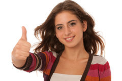 Portrait of a beautiful teenage girl gesturing success with thum Royalty Free Stock Image