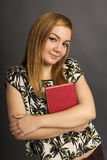 Portrait of  beautiful teenage girl holding  a book Royalty Free Stock Images