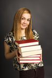 Portrait of  beautiful teenage girl holding many  books Stock Photography
