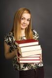 Portrait of  beautiful teenage girl holding many  books Stock Photography