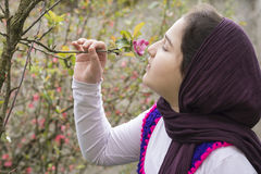 Portrait of a Beautiful Teenage Girl Outdoor in A Garden. Enjoying and  Smelling the Apple Tree buds Stock Images