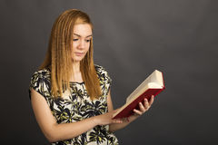Portrait of  beautiful teenage girl reading a  book Stock Photos
