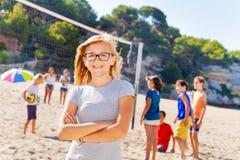 Beautiful teenage girl on beach volleyball court stock image