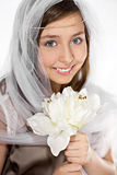 Teenage girl with veil and flowers Stock Photography