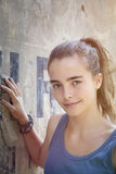 Portrait of a beautiful teenager girl. Leaning against a wall Stock Images