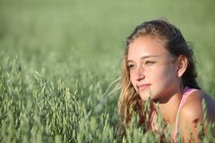 Portrait of a beautiful teenager girl in a oat meadow Royalty Free Stock Photo