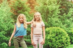Portrait of beautiful teenager girls twins at park. Portrait of beautiful teenager girls twins at park, lifestyle people concept Royalty Free Stock Photography
