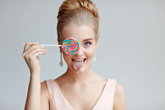 Portrait of beautiful tender blond girl with blue eyes in a pink royalty free stock photo
