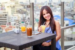 Portrait of beautiful thai asian women happy cheerful smiling. Portrait of beautiful thai asian woman happy cheerful smiling, sitting in a restaurant with a royalty free stock image