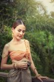 Portrait of beautiful Thai woman in traditional dress with costume in novel of queen cobra., Pretty of Thai girl is wearing. Vintage clothes and outdoor stock images