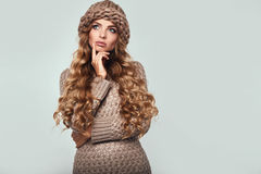 Portrait of beautiful thoughtful blond. Woman with long hair, brown sweater and hat Royalty Free Stock Photos