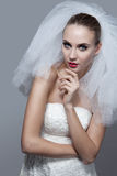 Portrait of beautiful thoughtful bride Stock Photography