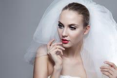 Portrait of beautiful thoughtful bride Stock Image