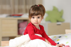 Portrait of a beautiful toddler girl in her room Stock Image