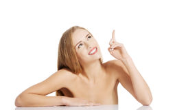Portrait of beautiful topless caucasian woman pointing up. Stock Photo