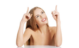 Portrait of beautiful topless caucasian woman pointing up. Royalty Free Stock Photo