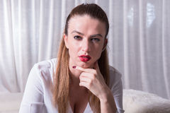 Portrait of a beautiful tough looking woman Stock Images