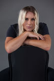 Portrait of beautiful transgender woman leaning on chair Stock Photos