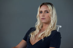 Portrait of beautiful transgender woman sitting on chair Stock Photography