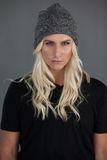 Portrait of beautiful transgender woman wearing knit hat Stock Photography