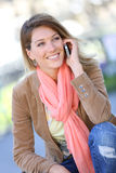 Portrait of beautiful trendy blond woman talking on phone. Portrait of blond woman using smartphone Stock Photos