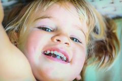 Portrait of a beautiful two year old  girl with blonde hair Stock Photo