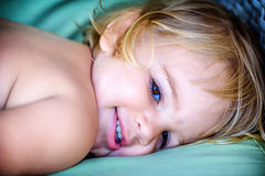Portrait of a beautiful two year old  girl with blonde hair Stock Image