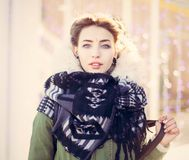 Portrait of a beautiful unusual girl in a green jacket with lights. Close up Stock Photo