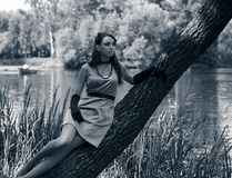 Beautiful vintage woman in summer park. Portrait of a beautiful vintage woman in summer park Stock Photos