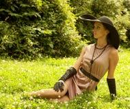 Beautiful vintage woman in summer park. Portrait of a beautiful vintage woman in summer park Stock Image