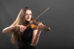 Portrait of a beautiful violinist Royalty Free Stock Image