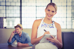 Portrait of a beautiful waitress taking an order Stock Image