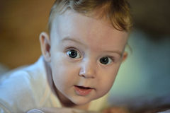 Portrait of a beautiful white big-eyed baby stock images